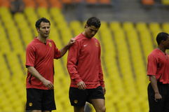 France Football 2009 Best 30 Players - Ronaldo. Ryan Giggs and Cristiano Ronaldo during the training session of Champions League Final 2007/08 in Moscow royalty free stock photography