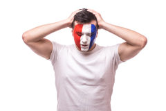 France football fan disapointed  of score of the game or lose  game of France national football team. Disapointed emotion, hands over head  on white background Stock Image