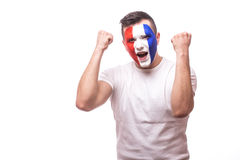 France football fan euphoric emotion of  score at match or win of the game  of France national football team. Euphoria emotion, hands over body and scream Stock Photo
