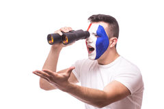France football fan look at game of France national football team over binoculars Royalty Free Stock Images