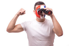 France football fan look at game of France national football team over binoculars Royalty Free Stock Photography