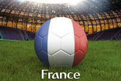 France football team ball on big stadium background. France Team competition concept. France flag on ball team tournament in Russi. A. Sport competition on green Stock Photo