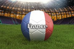 France football team ball on big stadium background. France Team competition concept. France flag on ball team tournament in Russi. A. Sport competition on green Stock Photography