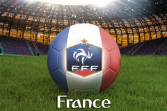 France football team ball on big stadium background with France Team logo competition concept. France flag on ball team tournament. In Russia. Sport competition Royalty Free Stock Photography