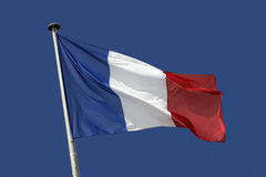 France - French Flag. Flag of France on a blue sky Stock Image