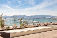 France, French riviera. Cannes. Beach. France, French riviera in Cannes beach. Panorama in sunny day Royalty Free Stock Image
