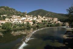 France, Herault, Roquebrun. Europe, France, Languedoc-Roussillon, Haut Languedoc, Herault 34, Roquebrun, River Orb, Hillside village by river royalty free stock photo
