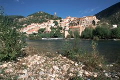 France, Herault, Roquebrun. The picturesque hillside village of Roquebrun by the River Orb, Herault, Languedoc-Roussillon, France royalty free stock photos