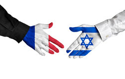 France and Israel diplomats shaking hands for political relations. Hands of two important leaders with national flags for the countries of France and Israel Royalty Free Stock Photos