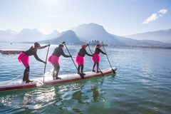 19.01.2019 - France Lake Annecy GlaGla Race 2019. SUP paddlers girl team is participating in race in France Alps lake stock photography