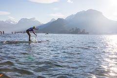 19.01.2019 - France Lake Annecy GlaGla Race 2019. SUP racers are participating in sport event. Lake Annecy in Franch royalty free stock photo