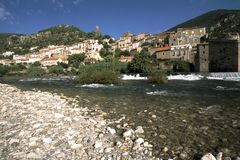 France, Languedoc-Roussillon, Herault, Roquebrun, River Orb, Hillside village. The picturesque hillside village of Roquebrun by the River Orb, Herault Royalty Free Stock Images