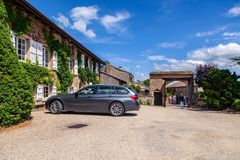 Free France Lyon 2019-06-20 People And European Station Wagon-type Cars Parked In The Courtyard Of Cozy Old Vintage House Overgrown Royalty Free Stock Photography - 155570837
