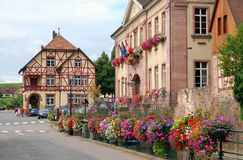 France, Mayoralty building in Riquewihr. France, Mayoralty building decorated with flowers in Riquewihr Stock Images