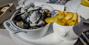 France Mussels with Friet. Mussels with Friet on a terras in France Royalty Free Stock Photography
