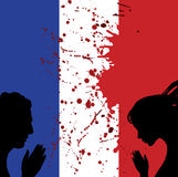 France national flag. People man and woman hands pray for Nice.  Royalty Free Stock Photography