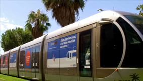 FRANCE NICE - AUGUST 2016: A modern French tram in the centre of Nice with beautiful banners stock video