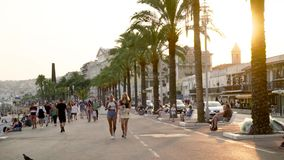 France, Nice - June, 2019: Busy street with walking tourists on warm summer day. Action. Palm trees, summer, beautiful. Streets of tourist city with lot of stock video