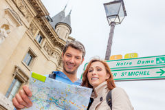 France notre dame. Map looking tourist in france Stock Photo