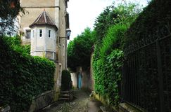 France- Noyers-sur-Serein Pathway and Architecture. A charming walkway through the back streets of Medieval Noyers-sur-Serein in Burgundy, France Stock Photo