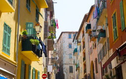FRANCE. Old town architecture of Nice on French Riviera. Narrow street in Nice city one of the most visited in France tourist Royalty Free Stock Photo