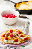 France  pancakes with cherry and cottage cheese Royalty Free Stock Photos