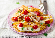 France  pancakes with cherry and cottage cheese Royalty Free Stock Photography