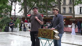 FRANCE, PARIS – MAY 25: STREET SHOW, musicians playing with vintage barrel organ and singing in Sunday market, MAY 25, 2014 stock video footage