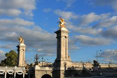 France, Paris, Alexander III Bridge. Under a blue sky with clouds Stock Photography