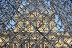 FRANCE, Paris 15 April 2015: Part of glass pyramid entrance to Louvre in Paris, France Stock Photography