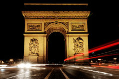 France, Paris: Arc de triomphe. France, Paris:  Night view of the famous avenue of Champs Elysees with the  Arc de Triomphe Royalty Free Stock Photo