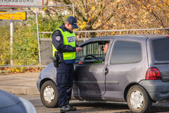 France Paris attacks - border surveillance with Germany. STRASBOURG, FRANCE - NOV 14 2015: French Police checking vehicles on the 'Bridge of Europe' between stock photos