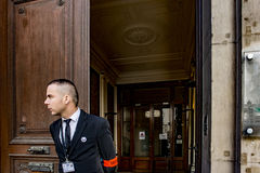 France, Paris August 5, 2017: A security guard at the entrance to the Paris office royalty free stock photos