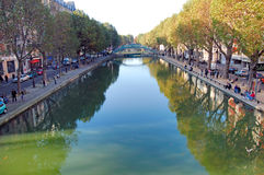 France, Paris: Canal Saint-Martin. Is a 4.5km long canal in Paris. autumn atmosphere, with yellow trees and blue river water royalty free stock photography