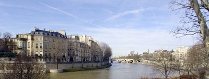 France, Paris: city view from the river. France, Paris: nice city view from the quai of the seine river; blue sky; naked trees and the river tranquility for this Royalty Free Stock Photo