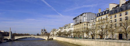 France; Paris; City view with seine river. France, Paris: nice city view from the quai of the seine river; blue sky; naked trees and the river tranquility for Royalty Free Stock Photography