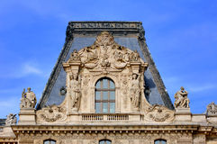 France, Paris: detail of Louvre Palace. France, Paris: ancient famous monuments Louvre Palace; architectural detail of the roof and windows. blue sky, white stock photo