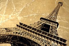France. Paris. Eiffel tower. France. Paris. View of openwork Eiffel tower in style old shabby photos. Photo on canvas with lighted edges Stock Image