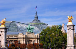 France, Paris: famous monuments. View of the Grand Palais dome framed by two gold leaf statues stock image