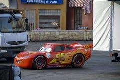 Lightning McQueen racing car into the Disney Studios, Paris. FRANCE, PARIS - February 28, 2016 - Lightning McQueen racing car from the movie Cars, making a speed royalty free stock photos