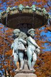 France, Paris: Fountain. France, Paris: autumn in paris with blue sky and a very nice bronze outdoor fountain with two statues stock photography