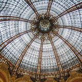 Galeries Lafayette is a passage with the glass dome. France Paris. Galeries Lafayette is a passage with the glass dome of Jacques Gruber and the decor in the Art royalty free stock images
