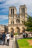 Tourists enjoy the view of the Cathedral of Notre Dame in Paris. FRANCE, PARIS - JUNE 01: Tourists enjoy sightseeing near the Cathedral of Notre Dame in Paris Royalty Free Stock Image
