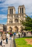 Tourists enjoy the view of the Cathedral of Notre Dame in Paris. FRANCE, PARIS - JUNE 01: Tourists enjoy sightseeing near the Cathedral of Notre Dame in Paris Stock Photo