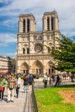Tourists enjoy the view of the Cathedral of Notre Dame in Paris. FRANCE, PARIS - JUNE 01: Tourists enjoy sightseeing near the Cathedral of Notre Dame in Paris Stock Images