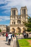Tourists enjoy the view of the Cathedral of Notre Dame in Paris. FRANCE, PARIS - JUNE 01: Tourists enjoy sightseeing near the Cathedral of Notre Dame in Paris Royalty Free Stock Photo