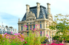 France, Paris: Louvre Palace. France, Paris: ancient famous monuments Louvre Palace; the most famous museum, nice architecture framed by the summer vegetation royalty free stock images