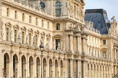 France, Paris: Louvre Palace. France, Paris: ancient famous monuments Louvre Palace, white stone and row of statues royalty free stock image