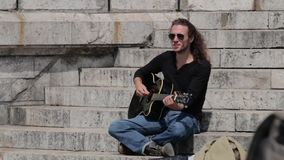 FRANCE, PARIS: Man playing guitar and signing, Montmartre stock footage