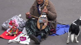 FRANCE, PARIS - MAY 25: senior woman musician emigrant playing on ancient violin in Paris street, MAY 25, 2014 stock video